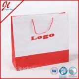 Bolsa de papel de encargo de lujo de las compras con insignia