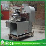 Máquina expulsando de petróleo de sementes do chá, petróleo que faz a máquina