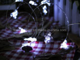 Corda pura da luz branca do homem a pilhas da neve para a decoração da árvore de Natal do feriado