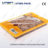 Máquina de empacotamento automática do mapa do vácuo de Thermoforming para Pinenuts que pesa o sistema de enchimento