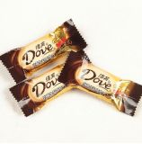 يشبع شوكولاطة آليّة يلفّ معدّ آليّ