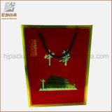 Il regalo di carta di lusso diTimbratura d'argento personalizzato di marchio di marchio insacca all'ingrosso, stampa del sacco di carta con la maniglia di seta