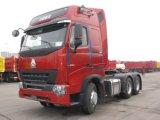 가득 차있는 장비를 가진 트럭을 운반하는 Sinotruk 420HP