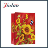 光沢のある薄板にされた塗被紙のヒマワリの安いショッピングギフトの紙袋