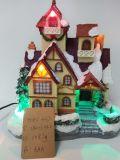 Mão por atacado o diodo emissor de luz pintado ilumina a casa do Natal dos edifícios da resina