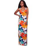 多色刷りの花柄の十字形の背部マキシの服