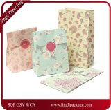 Sac de papier personnalisé par sac de pièce de sac de cadeau de papier d'imprimerie de modèle de cadeau de papier d'imprimerie de modèle de fleur