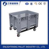 As caixas de pálete plásticas do armazenamento resistente enlatam com a caixa de pálete plástica da roda e da tampa
