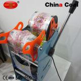 X01581手動Bobaの茶プラスチックコップのシーリング包装機械