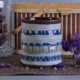 Sostenedor de vela de cerámica reactivo con final étnico de la pintura de la mano