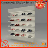 La scarpa da tennis del metallo calza la mensola di visualizzazione per il negozio