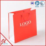 Kleine rosafarbene nette Papiereinkaufen-Beutel-fördernde Einkaufen-Beutel mit Firmenzeichen-Drucken