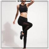 L'yoga su ordinazione all'ingrosso delle donne ansima i pantaloni di compressione con la casella laterale