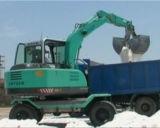 El excavador de la rueda con algodón ataca el equipo del cargamento del algodón