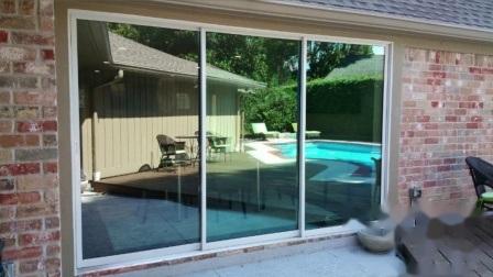 Prezzo di vetro provvisto di cardini/piegante/dell'alluminio di vetratura doppia dell'oscillazione scivolamento di alluminio dei portelli