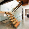 Modern Staircase Design with Floating Timber Steps and Glass Railing