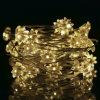 A forma a pilhas da estrela do anis ilumina acima a luz da corda - cor amarela