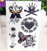 Etiqueta engomada temporal impermeable negra del tatuaje de la flor de mariposa