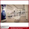 Muebles y apoyos elegantes de la visualización de la ropa de las señoras