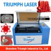 Precio chino del cortador del laser del mini de la mesa del laser del grabado de la cortadora 50W del laser triunfo del tubo