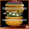 Plantador simple de piedra amarillo de la flor en el jardín Nsp040