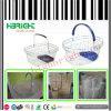 A medias alrededor de cesta de compras cosmética del acoplamiento de alambre con la sola maneta