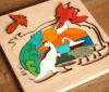 Rompecabezas hermoso interesante de madera de los animales