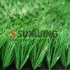 Césped verde plástico del deporte natural artificial al aire libre