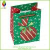 면 손잡이를 가진 다채로운 크리스마스 종이 선물 부대