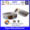 La insignia de la compañía imprimió la cinta adhesiva del lacre de embalaje