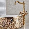A pintura do ouro de Flg de bronze Dual Faucet da bacia do banheiro dos punhos