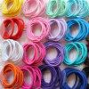 10 parti dei capelli di gomma di colori Mixed imballati scheda lega (JE1503)