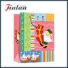 Bolso de compras del papel del diseño de la Navidad con la maneta del Organza