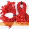 L'étiquette rouge de coup de boucle ficelle la corde de polyester