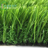 Jardín verde tricolor que ajardina la hierba artificial