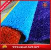 Un'erba artificiale decorativa domestica di quattro colori per le residenze
