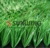 Césped verde plástico del jardín natural artificial al aire libre