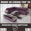 Le sofa vivant en cuir métallisé accessible de meubles a placé avec le tabouret