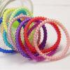 탄력 있는 나선형 전화선 연약한 반지 방수 플라스틱 Hairbands (JE1572)