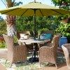 등나무 팔 의자를 식사하는 옥외 안뜰 가구 고리 버들 세공 정원