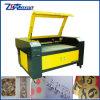 O dobro dirige a gravura do laser e a máquina de estaca
