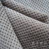 Tessuto della tappezzeria e decorativo del velluto a coste del sofà con la parte tessuta