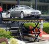 Um carregamento hidráulico de 4 toneladas estacionário scissor a tabela de elevador do carro