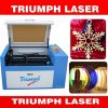 50W 60W Laser-Scherblock-Tischplattenminilaser-Gravierfräsmaschine für Kleinunternehmen-Triumph