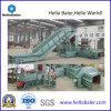 Prensa horizontal del papel usado de la prensa hidráulica con el transportador
