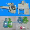 自動洗面所の洗剤のびんの収縮包装機械