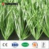 La alta densidad verde se divierte la hierba artificial