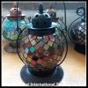 Linterna de cristal coloreada redonda usada para la vela