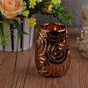 Suporte de vela de cerâmica de bronze com flor