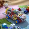 Sortiertes Fruchtgelee, wenn Spielzeug-Auto gelaufen wird